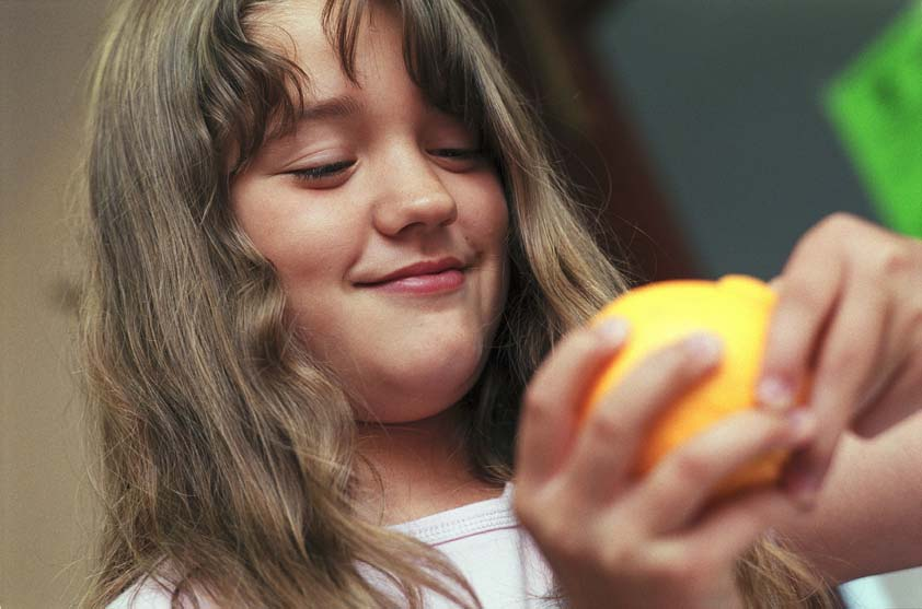 A child eating fruit