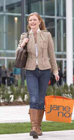 Woman with clothes shopping bags